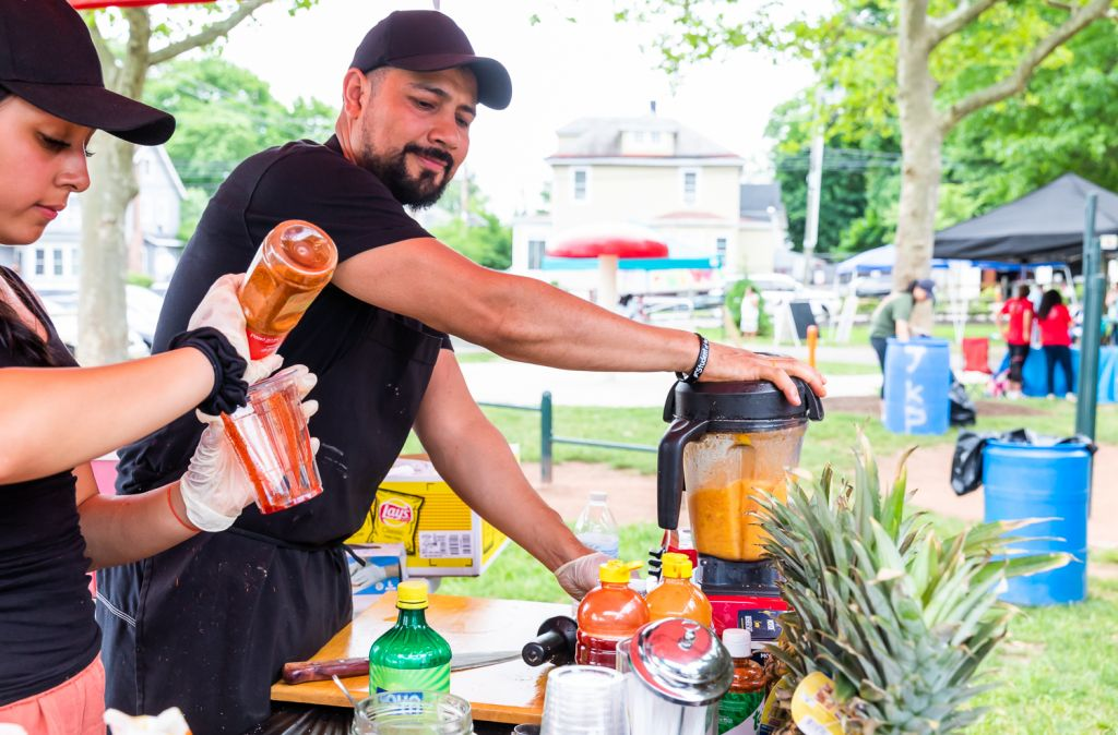 Saul & Anel Jauregui serving Mangonadas & Natural juices